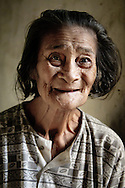 Philippines, Batanes. Portrait of Lola Ida, the elderly inhabitant of House of Dakay, the oldest building on Batan Island,