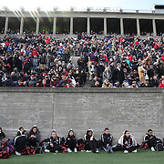 Harvard cheerleaders take a break during the Harvard Vs Yale, College Football, Ivy League deciding game, Harvard Stadium, Boston, Massachusetts, USA. 22nd November 2014. Photo Tim Clayton