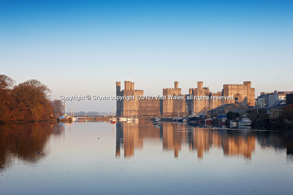 General view from the south east<br /> Caernarfon Castle <br /> Cadw Sites<br /> World Heritage Sites<br /> SAMN: CN079<br /> NGR: SH477626<br /> Gwynedd<br /> North<br /> Castles<br /> Medieval<br /> Defence<br /> Historic Sites