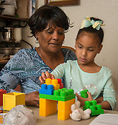 Odella Colbert reads with her grandchildren Devin and Donovan, January 22, 2015.