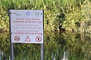 Israel, Hadera stream a seasonal watercourse nature reserve Contaminated water warning sign