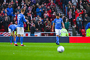 Gareth Evans of Portsmouth (26) reacts to Chris Maguire of Sunderland (7) scoring a goal to make the score 1-0 during the EFL Sky Bet League 1 first leg Play Off match between Sunderland and Portsmouth at the Stadium Of Light, Sunderland, England on 11 May 2019.