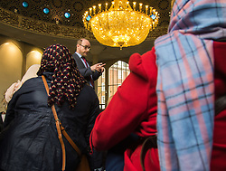 Regents Park Mosque, London, February 5th 2017. Dozens of curious non-Muslims are welcomed at Regent's Park Mosque in London as part of the Muslim Council of Britain's annual 'Visit My Mosque Day'. Visitors were able to observe prayers and we shown around the mosque by members, where there was a exhibition of the history and teachings of Islam. PICTURED: PICTURED: Visitors are seated in the men's prayer hall as the functioning of the Mosque.