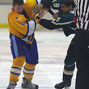 Southern Stampede player Michael Sommer and Hassan Saeed fight before both being ejected from the game during the Southern Stampede V Dunedin Thunder National Ice Hockey League match at the Queenstown Ice Arena , South Island, New Zealand, 25th June 2011
