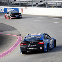 Jeb Burton (51) races through turn three to practice  for the First Data 500 at Martinsville Speedway in Martinsville, Virginia.