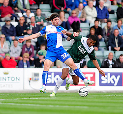 Bristol Rovers' John-Joe OToole jostles for the ball with Plymouth Argyle's Reuben Reid  - Photo mandatory by-line: Dougie Allward/JMP - Tel: Mobile: 07966 386802 07/09/2013 - SPORT - FOOTBALL -  Home Park - Plymouth - Plymouth Argyle V Bristol Rovers - Sky Bet League Two