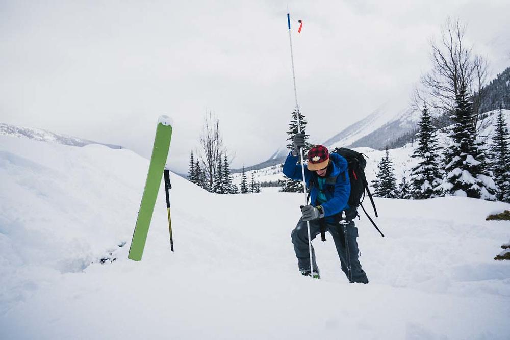 Erme Catino executes an avalanche drill, Burnie Glacier Chalet, Howson Range, British Columbia.