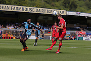 Dave Winfield wins a header during the Sky Bet League 2 match between Wycombe Wanderers and York City at Adams Park, High Wycombe, England on 8 August 2015. Photo by Simon Davies.