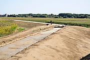 Nederland, the Netherlands, 1-9-2018Dijkversterking tussen Lottum en Grubbenvorst langs de rivier de Maas. Een van de projecten om het maaswater te beteugelen bij hoogwater . Hier wordt een nieuw stuk dijk aangelegd . Grondverzet door Ploegam . Foto: Flip Franssen