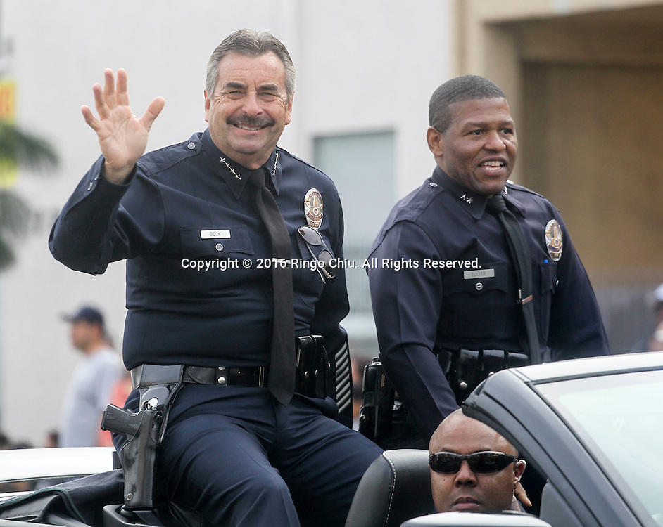 Los Angeles Police Chief Charlie Beck, left and Deputy Chief William Scott wave during during the Martin Luther King Jr. parade in Los Angeles on Monday Jan. 18, 2016. The 31st annual Kingdom Day Parade honoring Martin Luther King Jr. was themed &quot;Our Work Is Not Yet Done&quot;(Photo by Ringo Chiu/PHOTOFORMULA.com)<br /> <br /> Usage Notes: This content is intended for editorial use only. For other uses, additional clearances may be required.