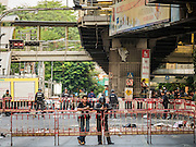18 AUGUST 2015 - BANGKOK, THAILAND: Thai security personnel on duty at Erawan Shrine Tuesday morning. An explosion at Erawan Shrine, a popular tourist attraction and important religious shrine in the heart of the Bangkok shopping district killed at least 20 people and injured more than 120 others, including foreign tourists, during the Monday evening rush hour. Twelve of the dead were killed at the scene. Thai police said an Improvised Explosive Device (IED) was detonated at 18.55. Police said the bomb was made of more than six pounds of explosives stuffed in a pipe and wrapped with white cloth. Its destructive radius was estimated at 100 meters.    PHOTO BY JACK KURTZ