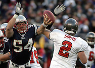 New England Patriot Linebacker Tedy Bruschi applies pressure to Tampa Bay's Quarterback Chris Simms.  New England hammered Tampa Bay's offensive all game with intense pressure in an impressive 28-0 victory at Gillette Stadium, Foxboro, MA