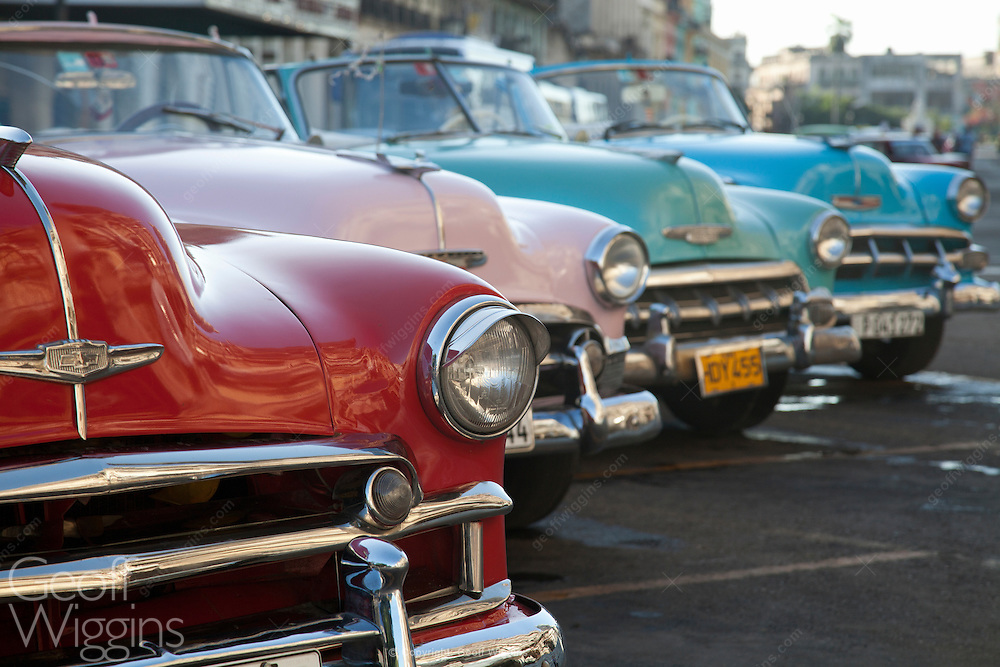 Line up of 1950s vintage Chevrolet Styleline DeLuxe Convertibles outside El Capitolio, Havana, Cuba