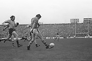 Kerry bounces the ball on his foot while running from Dublin during the All Ireland Senior Gaelic Football Final, Kerry v Dublin in Croke Park on the 28th September 1975. Kerry 2-12 Dublin 0-11.