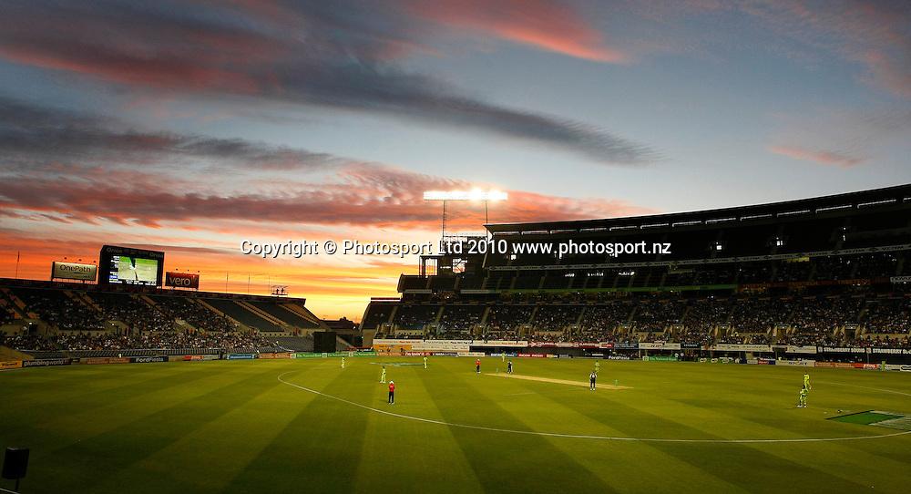 The sun sets over AMI Stadium. New Zealand Black Caps v Pakistan, Match 3. Twenty 20 Cricket match at AMI Stadium, Christchurch, New Zealand. Thursday 30 December 2010. Photo: Simon Watts/photosport.co.nz