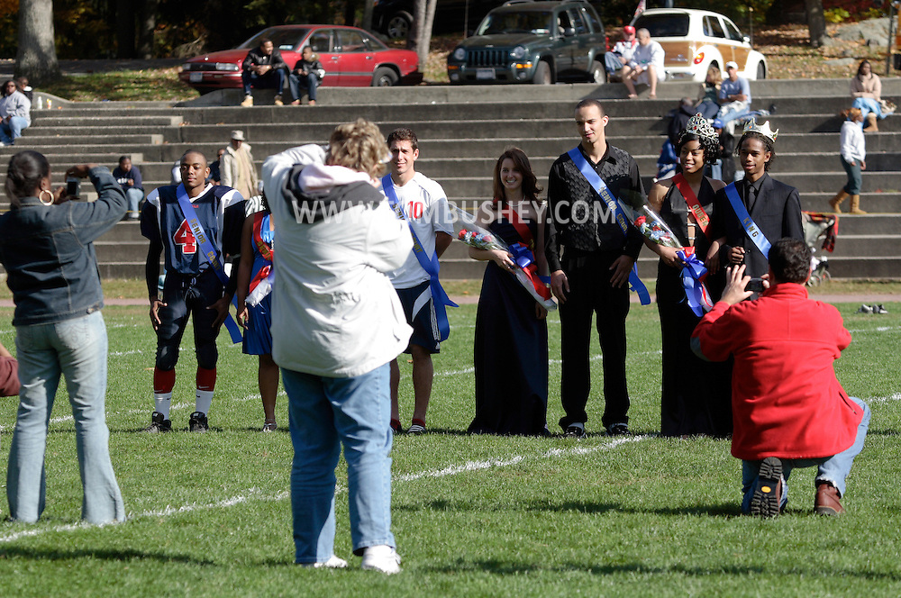 Peekskill, NY - The homecoming king and queen and members of their court stand on the football field and pose for photographs at halftime of a game between Poughkeepsie and Peekskill in Peekskill on Oct. 18, 2008.