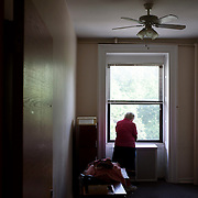 June 1, 2016 - New York, NY : The Missionary Sisters of the Immaculate Heart of Mary (I.C.M.)  are selling their 25-bedroom, two-story, combined two-townhome property located at 236 East 15th Street. Here, Sister Cecilia Palange pauses, on Wednesday afternoon, to look out of the window of the room she used to inhabit at 236 East 15th Street. She enjoyed watching the seasons change in neighboring Stuyvesant Square.  CREDIT: Karsten Moran for The New York Times