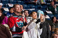 KELOWNA, CANADA - FEBRUARY 10: Game host Brian Mac stands in the crowd with fans during a time out against the Vancouver Giants on February 10, 2017 at Prospera Place in Kelowna, British Columbia, Canada.  (Photo by Marissa Baecker/Shoot the Breeze)  *** Local Caption ***