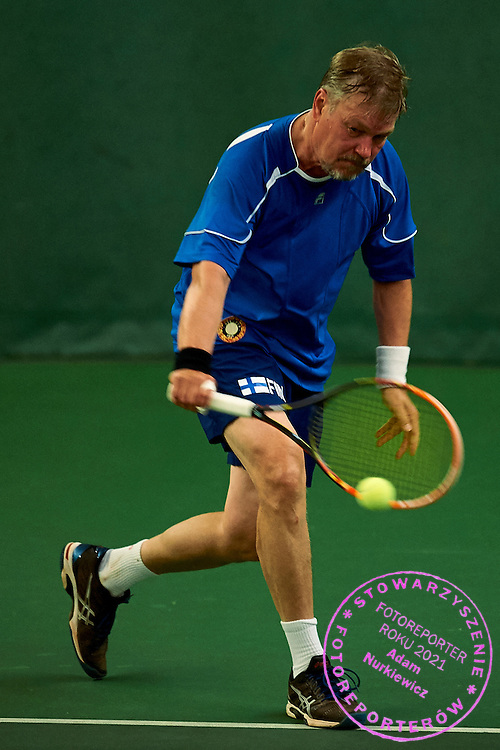 Helsinki, Finland - 2016 June 25: Matti Virtanen from Finland in action while MS55 - Singles Main Draw match during 36th ITF Seniors World Individual Championships 2016 at Talin Tenniskeskus on June 25, 2016 in Helsinki, Finland.<br /> <br /> Adam Nurkiewicz declares that he has no rights to the image of people at the photographs of his authorship.<br /> <br /> Picture also available in RAW (NEF) or TIFF format on special request.<br /> <br /> Any editorial, commercial or promotional use requires written permission from the author of image.<br /> <br /> Mandatory credit:<br /> Photo by &copy; Adam Nurkiewicz