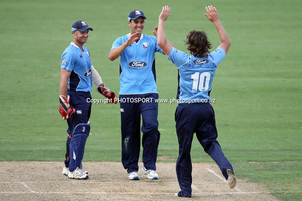 A barefoot Lou Vincent celebrates the wicket of Nick Beard with Gareth Hopkins and Anaru Kitchen during the semi final ODI playoff match, Auckland Aces v Otago Volts. Colin Maiden Park, Auckland. Wednesday 9 February 2011. Photo: Ella Brockelsby/photosport.co.nz