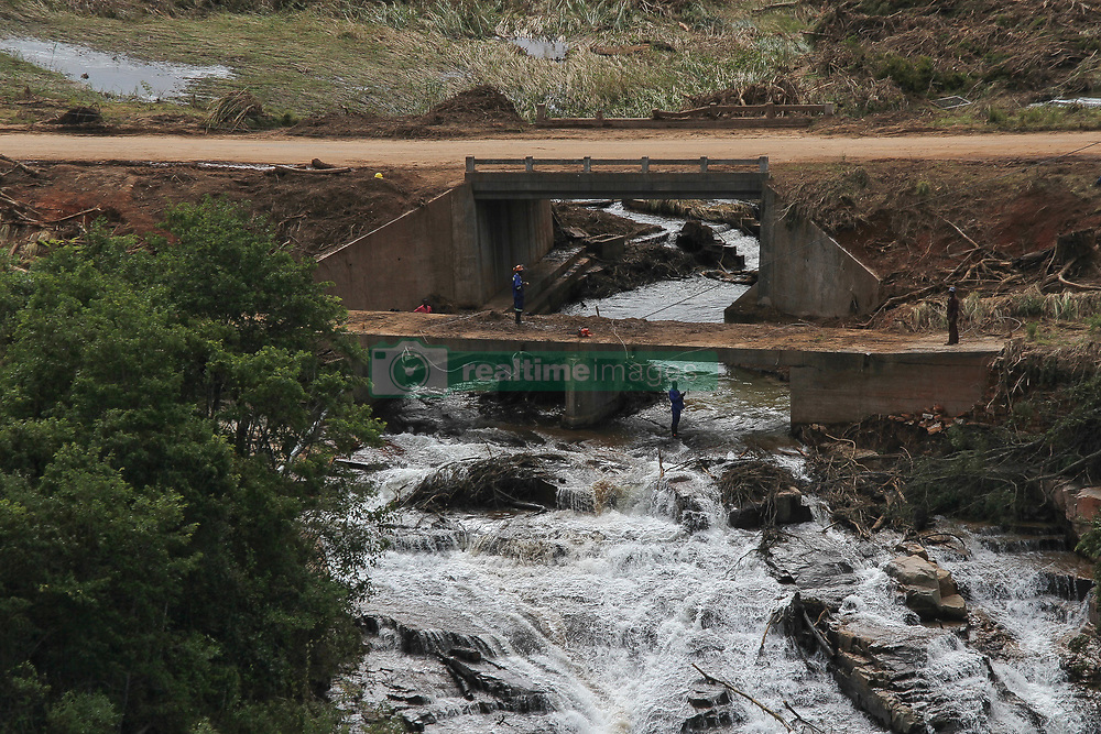 March 24, 2019 - Zimbabwe - Engineers work on a damaged bridge in order to create access to other town near by.  At least 259 people were killed in Zimbabwe by Cyclone Idai, and some 217 are missing, according to the U.N. migration agency. Hundreds of people had been injured and authorities had confirmed that 16,000 households had been displaced, the International Organization said in a statement. (Credit Image: © Tafadzwa Ufumleli/ZUMA Wire)