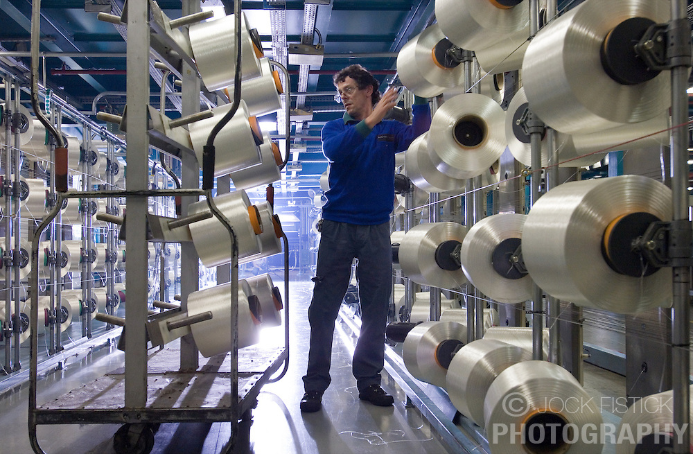 LONGLAVILLE, FRANCE - JUNE-22-2006 - Performance Fiber employees work in the Fibers Department at the Performance Fibers plant in Longlaville, France.