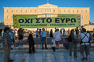 Thousands of people demonstrating in Athens against the EU imposed VAT increase on products and services. the Greek Parliament voted in spite of the demonstrations for a new package of measures which the international lenders demand in return for a new emergency loan.  mood, angry, disappointed, riot, disagreement