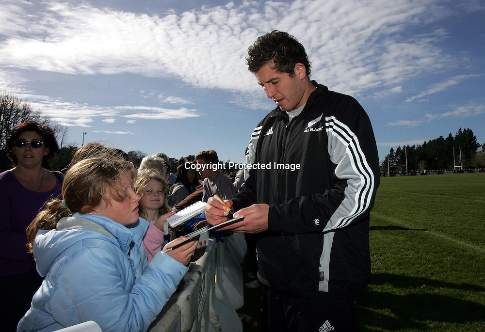 Simon Maling signs autographs for fans during the All Blacks training session at Silverdale United RFC, North of Auckland, New Zealand, Wednesday 7th July 2004. The All Blacks play the Pacific Islanders on Saturday.<br />