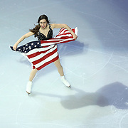 Marissa Castelli skates with an American flag during the Smucker's Skating Spectacular at the TD Garden on January 12, 2014 in Boston, Massachusetts.