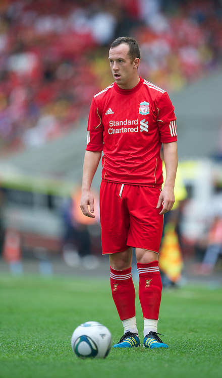 KUALA LUMPUR, MALAYSIA - Saturday, July 16, 2011: Liverpool's new signing Charlie Adam in action against a Malaysia XI at the National Stadium Bukit Jalil in Kuala Lumpur on day six of the club's Asia Tour. (Photo by David Rawcliffe/Propaganda)