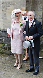 SIR JACKIE & LADY STEWART at the wedding of the Hon.Alexandra Knatchbull to Thomas Hooper held at Romsey Abbey, Romsey, Hampshire on 25th June 2016