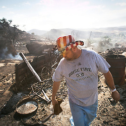 Steven Danielson walks among the ruins of his house which was burned last night during a fire that began about midnight near Wild Horse subdivision north of Table Rock. Strong winds pushed the fire around Table Rock and south toward Warm Springs Mesa subdivision and Harris Ranch, threatening hundreds of homes. By late morning, the fire had grown to 2,500 acres and had destroyed the Danielson home and one outbuilding.  Thursday June 30, 2016
