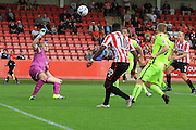 Amari Morgan-Smith strikes the ball to score his first goal of the game during the Vanarama National League match between Cheltenham Town and Southport at Whaddon Road, Cheltenham, England on 15 August 2015. Photo by Antony Thompson.