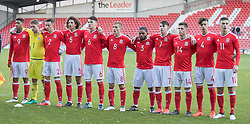 WREXHAM, WALES - Thursday, November 10, 2016: Wales' players sing the national anthem before kick off against Greece during the UEFA European Under-19 Championship Qualifying Round Group 6 match at the Racecourse Ground. (Pic by Gavin Trafford/Propaganda)