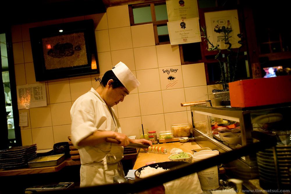 Sushi chefs Etsuo Shoda at Sushi Village at the Trattoria, a restaurant  at Whistler-Blackcomb ski resort in British Columbia, Canada.
