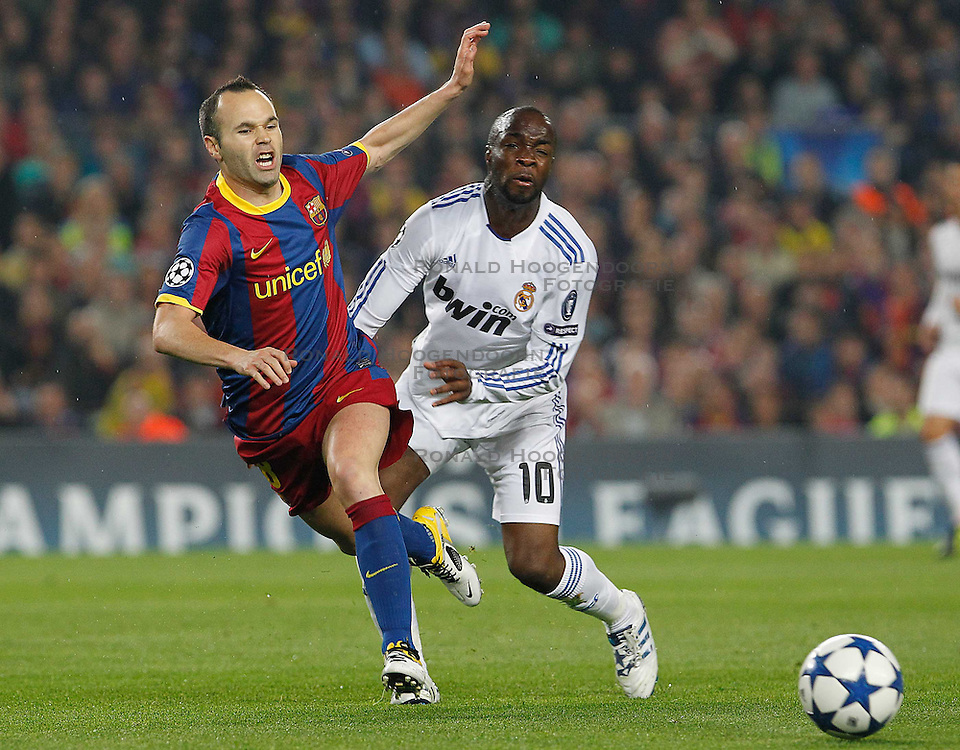 03-05-2011 VOETBAL: SEMI FINAL CL  FC BARCELONA - REAL MADRID: BARCELONA<br /> Andres Iniesta (l) and Lass Diarra <br /> *** NETHERLANDS ONLY***<br /> &copy;2011-FH.nl- EXPA/ Alterphotos/ Acero