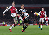 Football - 2017 / 2018 Premier League - Arsenal vs. Newcastle United<br /> <br /> Laurent Koscielny (Arsenal FC) and Dwight Gayle (Newcastle United)  compete for the ball at The Emirates.<br /> <br /> COLORSPORT/DANIEL BEARHAM