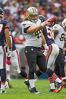 06 October 2013: Fullback (45) Jed Collins of the New Orleans Saints points the ball afar getting a first down against the Chicago Bears during the second half of the Saints 26-18 victory over the Bears in an NFL Game at Soldier Field in Chicago, IL.