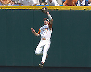 Texas right fielder Nick Peoples makes a leaping catch against Florida in the third inning.  Texas defeated Florida 6-2 for the National Championship at the College World Series at Rosenblatt Stadium in Omaha, Nebraska on June 26, 2005.