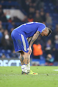 Chelsea attacker Kenedy (16) looking unhappy after losing during the Champions League match between Chelsea and Paris Saint-Germain at Stamford Bridge, London, England on 9 March 2016. Photo by Matthew Redman.
