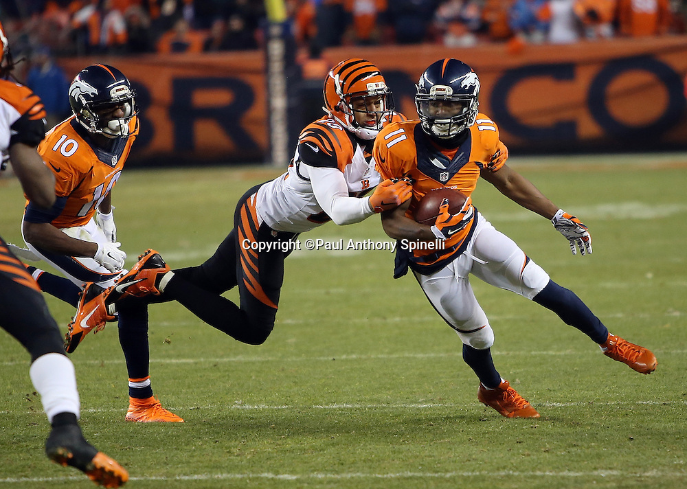 Denver Broncos wide receiver Jordan Norwood (11) catches an 8 yard fourth quarter pass to the Cincinnati Bengals 37 yard line as he breaks a diving tackle attempt by Cincinnati Bengals free safety Reggie Nelson (20) during the 2015 NFL week 16 regular season football game against the Cincinnati Bengals on Monday, Dec. 28, 2015 in Denver. The Broncos won the game in overtime 20-17. (©Paul Anthony Spinelli)
