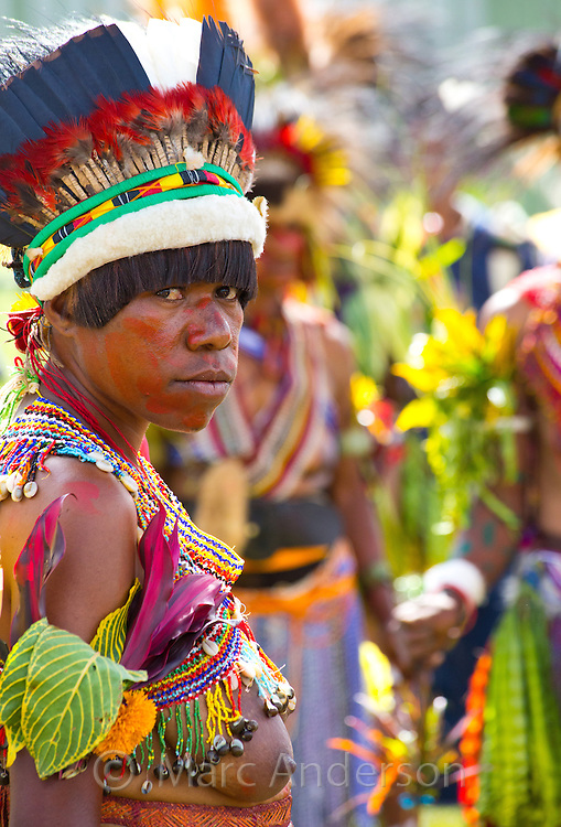 Portrait of a woman from the Bena region dressed in traditional Bena tribal dress for the Goroka Show, an annual Singsing Festival in the highlands of Papua New Guinea