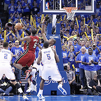 12 June 2012: Miami Heat small forward LeBron James (6) goes to the basket against Oklahoma City Thunder small forward Kevin Durant (35) during the Oklahoma City Thunder 105-94 victory over the Miami Heat, in Game 1 of the 2012 NBA Finals, at the Chesapeake Energy Arena, Oklahoma City, Oklahoma, USA.