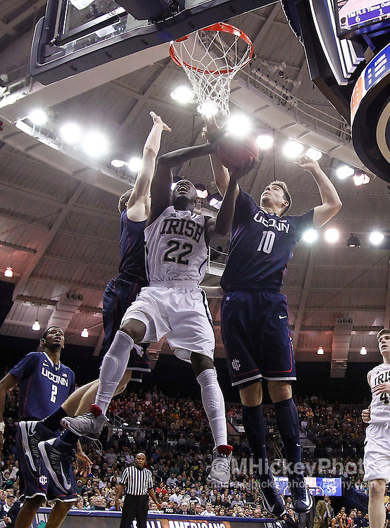 SOUTH BEND, IN - JANUARY 12: Jerian Grant #22 of the Notre Dame Fighting Irish shoots between Niels Giffey #5 and Tyler Olander #10 of the Connecticut Huskies at Purcel Pavilion on January 12, 2012 in South Bend, Indiana. Connecticut defeated Notre Dame 65-58. (Photo by Michael Hickey/Getty Images) *** Local Caption *** Jerian Grant; Niels Giffey; Tyler Olander