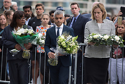 @Licensed to London News Pictures 05/06/17. City Hall, London, UK. Diane Abbott MP, The London mayor Sadiq Khan and Home Secretary Amber Rudd make their way to the flag post outside City Hall today to lay flowers at a vigil to remember the victims of the London Bridge terror attack. Photo credit: Manu Palomeque/LNP