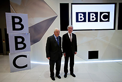 © London News Pictures. 22/11/2012. London, UK. Chairman of the BBC Trust, Lord Patten (left) and Tony Hall (right), the new Director General of the BBC pose for photographers before a press conference held at the BBC's Broadcasting House in central London following the appointment of Tony Hall as director general. Tony Hall takes over from George Entwistle who resigned following controversy surrounding Newsnight and Panorama programmes. Photo credit: Ben Cawthra/LNP