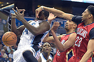 New Orleans Pelicans forward Anthony Davis (23) blocks a shot by Orlando Magic forward Andrew Nicholson (44) as guard Victor Oladipo, second from left, and Pelicans center Alexis Ajinca (42) watch during the second half of an NBA basketball game in Orlando, Fla., Monday, Dec. 28, 2015. The Magic won 104-89. (AP Photo/Phelan M. Ebenhack)