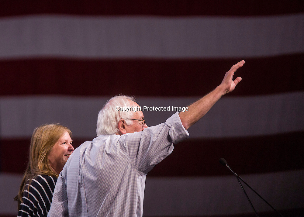 Democratic presidential candidate Sen. Bernie Sanders, I-Vt., with his wife Jane, waves at a rally, Monday, Aug. 10, 2015, at the Los Angeles Memorial Sports Arena in Los Angeles. (AP Photo/Ringo H.W. Chiu)