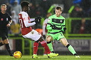 Forest Green Rovers Ben Morris(22) takes on Arsenal's Bukayo Saka(87) during the EFL Trophy group stage match between Forest Green Rovers and U21 Arsenal at the New Lawn, Forest Green, United Kingdom on 7 November 2018.