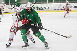 Pesut Ziga of HK Olimpija and Primann Markus of EC Kac II during Ice Hockey match between HK SZ Olimpija and EC KAC II during 1st round of Alps Hockey League 2019/20, on September 14, 2019, in Hala Tivoli, Ljubljana, Slovenia. Photo by Grega Valancic